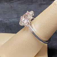 custom rings made in white gold with a morganite center stone surrounded by diamonds