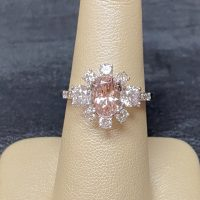 custom ring made in white gold with morganite center stone surrounded by diamonds